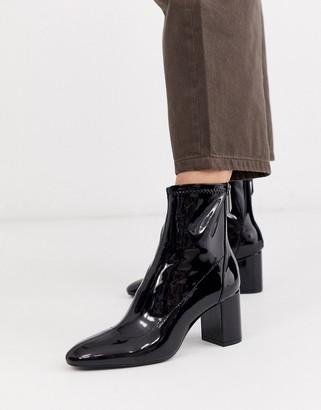 Stradivarius patent heeled boots in black