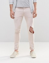 Asos Super Skinny Jeans With Open Rips In Light Pink