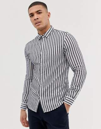 Celio slim fit long sleeve shirt with navy vertical stripe in white