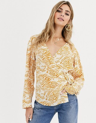 ASOS DESIGN wrap top with belt detail in abstract print
