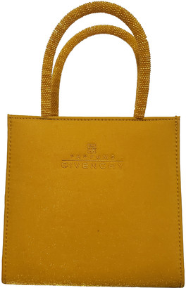 Givenchy Yellow Cloth Travel bags
