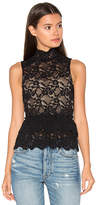 Nightcap Clothing Peplum Cut Out Top in Black. - size 3 (also in )