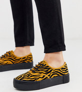 Monki tiger print faux suede platform plimsolls in black and mustard