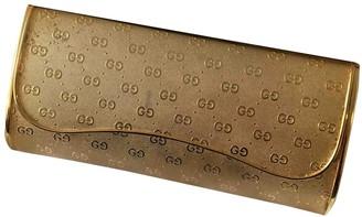 Gucci Gold Metal Clutch bags