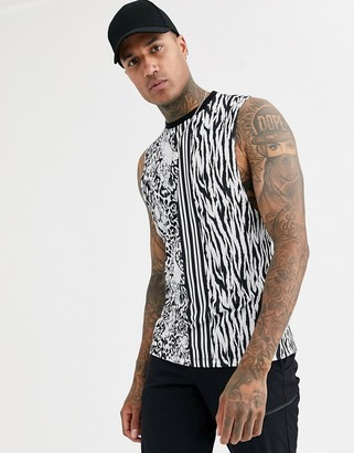 Asos Design DESIGN relaxed sleeveless organic cotton t-shirt with dropped armhole in all over animal print-White