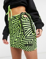 Nicce mini skirt with ruching in graphic mesh