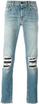 Saint Laurent distressed skinny jeans - men - Cotton/Polyurethane - 29