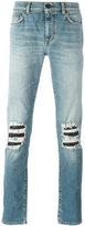 Saint Laurent distressed skinny jeans - men - Cotton/Polyurethane - 33