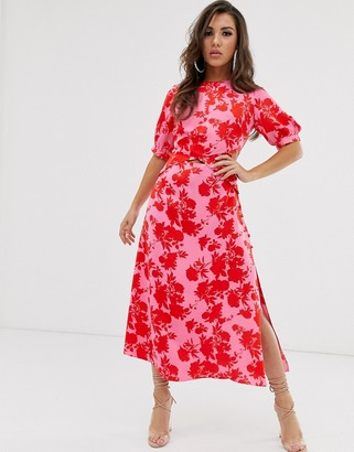 Asos DESIGN puff sleeve wrap front midi dress with cutout in floral print