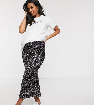 Asos DESIGN Maternity jersey midi slip skirt in black ditsy daisy print