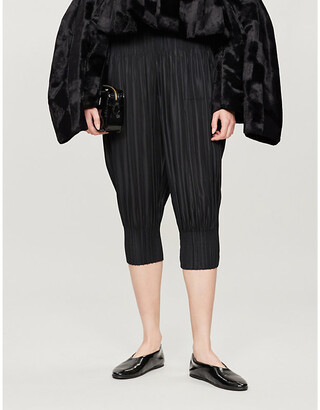Pleats Please Issey Miyake Cropped high-rise tapered pleated trousers