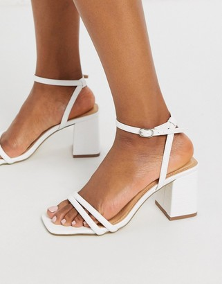 Truffle Collection thin strap mid heeled square toe sandals in white