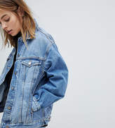 Asos DESIGN Petite denim girlfriend jacket in lightwash blue