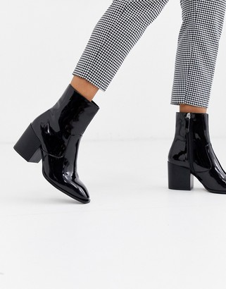 Faith Busted black patent mid heeled ankle boots