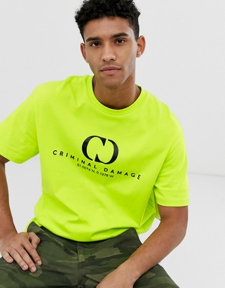 Criminal Damage oversized t-shirt in neon yellow with logo