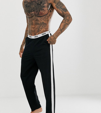 Asos Design DESIGN lounge pyjama bottom in black with side stripe and branded waistband