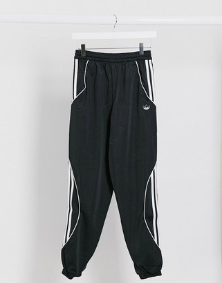 adidas Fatken cuffed joggers in black with leg detailing
