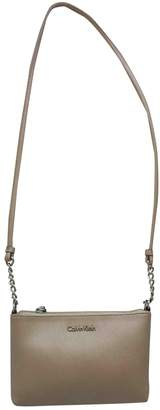 Calvin Klein Gold Leather Handbags