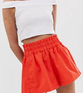 Asos DESIGN Petite denim short with gathered waist detail in red