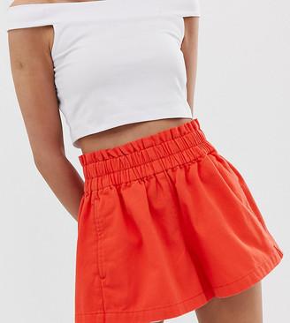 Asos DESIGN Petite denim short with gathered waist detail in red