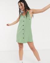 Monki Nea sleeveless button through dress in green