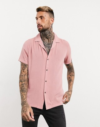 ASOS DESIGN regular fit shirt in crinkle viscose with revere collar in pink