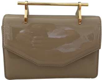M2Malletier Beige Patent leather Clutch bags