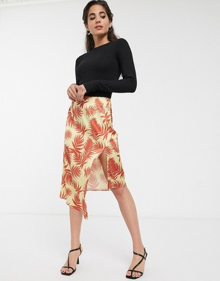 Glamorous asymmetric midi skirt with frogging in palm print