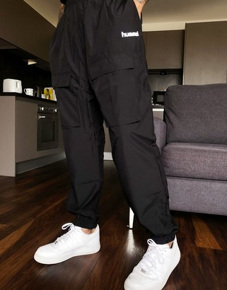 Hummel Hive cargo pants with front pockets in black