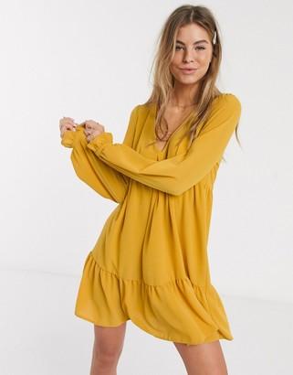ASOS DESIGN v neck mini smock dress with pep hem in mustard