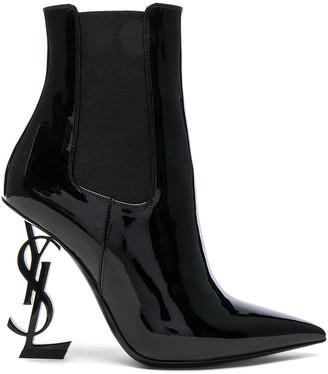 Saint Laurent Patent Opium Monogramme Heeled Boots in Black & Black | FWRD