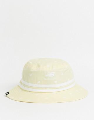 New Balance AOP bucket hat in yellow