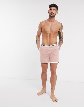 Asos DESIGN lounge runner short in dusty pink and branded waistband