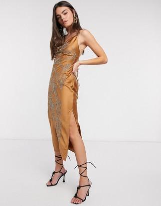 ASOS DESIGN satin embellished cowl slip dress with lace up back in Bronze