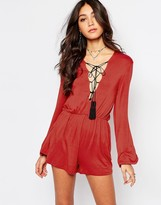 LIRA Festival Romper With Lace Up Front And Fluted Sleeve