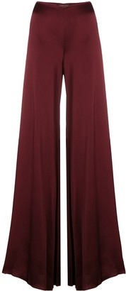 Romeo Gigli Pre Owned glossy flared trousers