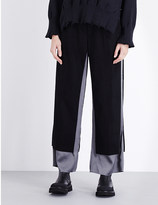 Undercover Contrast wool and cashmere-blend trousers