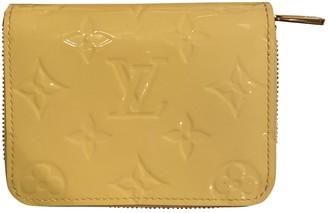 Louis Vuitton Zippy Yellow Patent leather Wallets