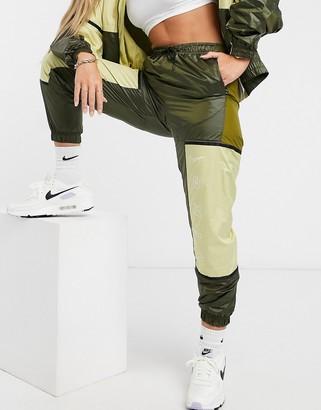 Nike colour block woven joggers in khaki green