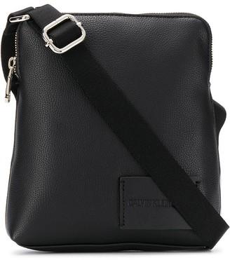 Calvin Klein Logo Embossed Messenger Bag