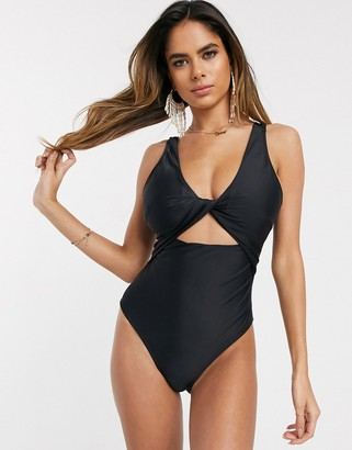 ASOS DESIGN recycled fuller bust supportive twist front cut out swimsuit in black dd