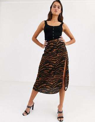 Motel midi skirt with thigh split in animal print