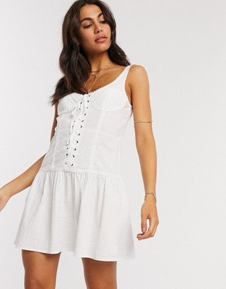 Asos DESIGN lace up sundress with lace inserts in white