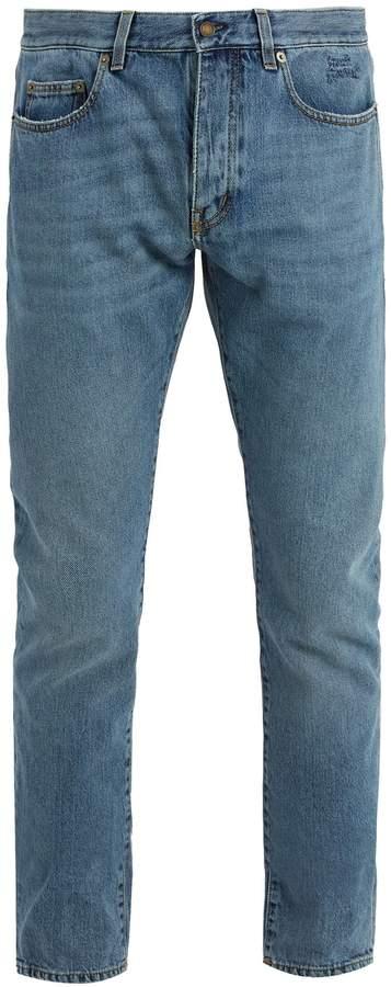 Saint Laurent Slim-leg logo-embroidered jeans
