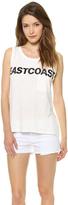 lea michele  Who made Lea Micheles black headband, white print tank top, sunglasses, leather handbag, and sneakers?