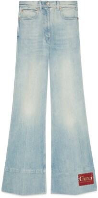 Gucci Washed denim flare pant with label