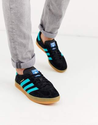 adidas Gazelle trainers in black with gum sole