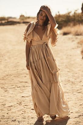 Erika Pena Vale Ruffled Maxi Dress By in Beige