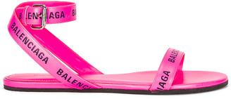 Balenciaga Round Flat Sandals in Neon Pink & Black | FWRD