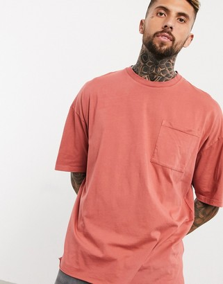 ASOS DESIGN oversized T-shirt with pocket in washed pink